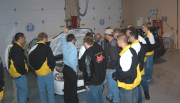 Students and instructors check out a natural-gas powered car and equipment used in biodiesel production.