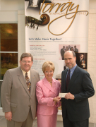 WVU\'s first couple, David and Susan Hardesty, present a check to Larry Tamburri, president of the Pittsburgh Symphony Orchestra, for their subscription to a series of concerts resulting from an expanded partnership between WVU and the symphony.