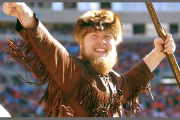 Trey Hinrichs, the 2002-03 mascot, revs up a football crowd at Mountaineer Field. WVU\'s Mountaineer mascot officially turns 70 this year.