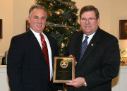 Special agent Ray Morrow (left), who oversees operations at the FBI\'s Pittsburgh field office, presents WVU President David C. Hardesty Jr. with a plaque in recognition of his service on the National Security Higher Education Advisory Board.