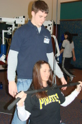 Rec Center personal trainer Brandon Ditty helps WVU student Rachel Knotts develop an individualized exercise program to meet her goals. The Rec Center is now offering free personal training to its members.