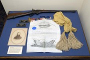 The portrait, rifle, sash and commission of Civil War Gen. Thomas Harris is among the items on display at the West Virginia and Regional History Collection in the Wise Library on WVU\'s Downtown Campus.