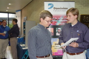 Chris Knight (right), a 2004 graduate of WVU with a degree in petroleum engineering, speaks with a WVU student about about opportunities in the oil and natural gas industries during last year\'s Engineering and Computer Science Career Fair. Knight wa