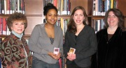 WVU students Nalisa Robinson and Emily Corio (center, from left) won iPod Nanos in a contest to promote the University Libraries\' Web site. They are pictured with associate dean Myra Lowe (right) and Beth Toren, web services librarian.
