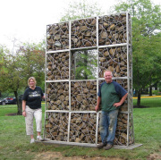 Alison Helm, chair of the Division of Art and Design in the WVU College of Creative Arts, and contemporary artist Kevin Lyles of Gallipolis, Ohio, flank Lyles' sculpture on the grounds of the Creative Arts Center. Lyles is a former visiting sculptor