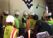 Researchers from West Virginia University examine a giant inflatable airbag during a test in August in Washington, D.C. The researchers from WVU's College of Engineering and Mineral Resources believe the airbag has the potential to seal off tunnels t