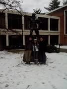 Eduardo Daniel Bravo Solis, Odette Camacho Montano and Gabriel Ramirez Zrazua pose with the Mountaineer statue after the first snow the trio from Mexico had ever seen